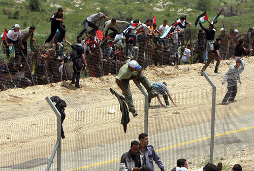 bin laden 39 s reign at. Syrians stream over the border fence challenging Israel#39;s sovereignty