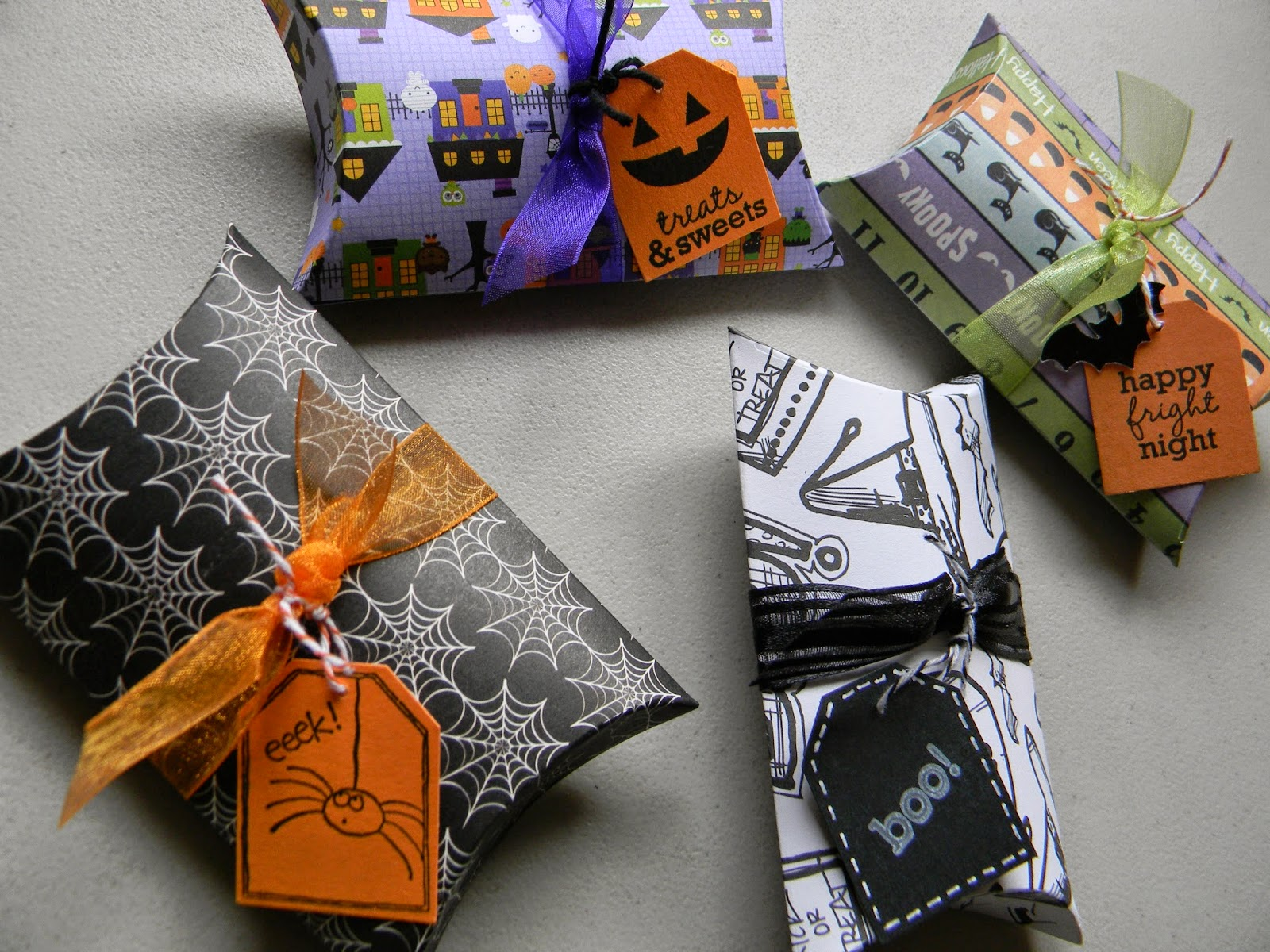 i used ptis pillow box die with assorted halloween dsp added ribbon around the middle and then had fun making all kinds of different tags from my - Halloween Treat Holders