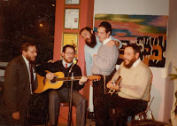 Reb Yosil (guitar, on right) Avraham Fried (the fellow with the beard who's standing and singing) and friends