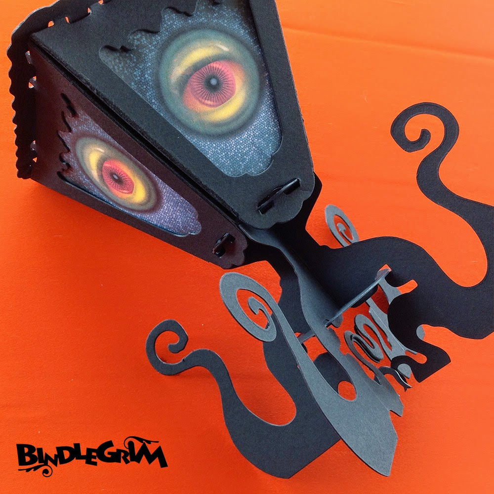 Eight-limbed octopus monster black silhouette with large eye-balls by Bindlegrim for Bindlegoods Spooklights series