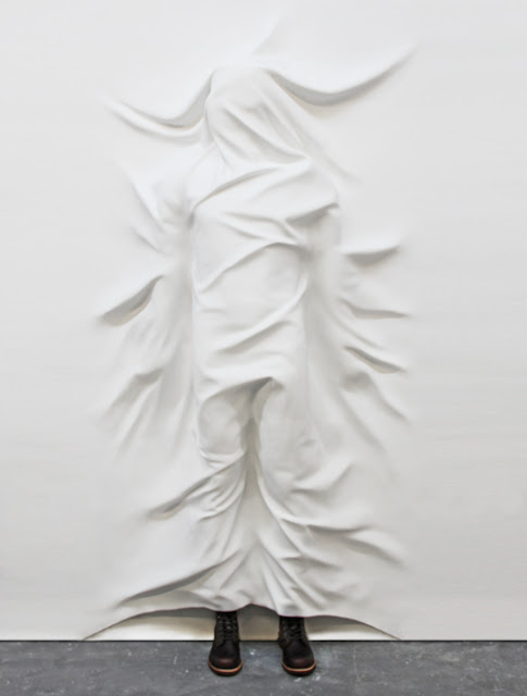 draped human body, draped installation, white installation, draped human, sheets installation, bedding installation, wall installation