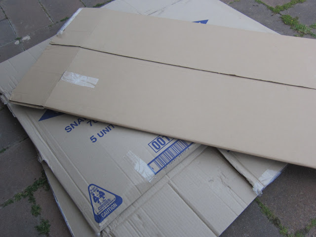 cardboard boxes in the garden