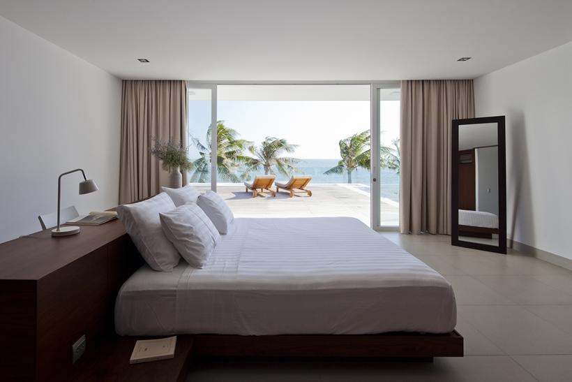 Modern bedroom in modern beach house