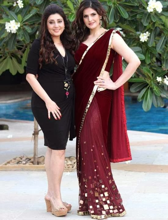 "Red Saree with matching Maroon Velvet Blouse with Sleeveless and Backless Designs is prepared by none other than ""Archana Kochhar""."