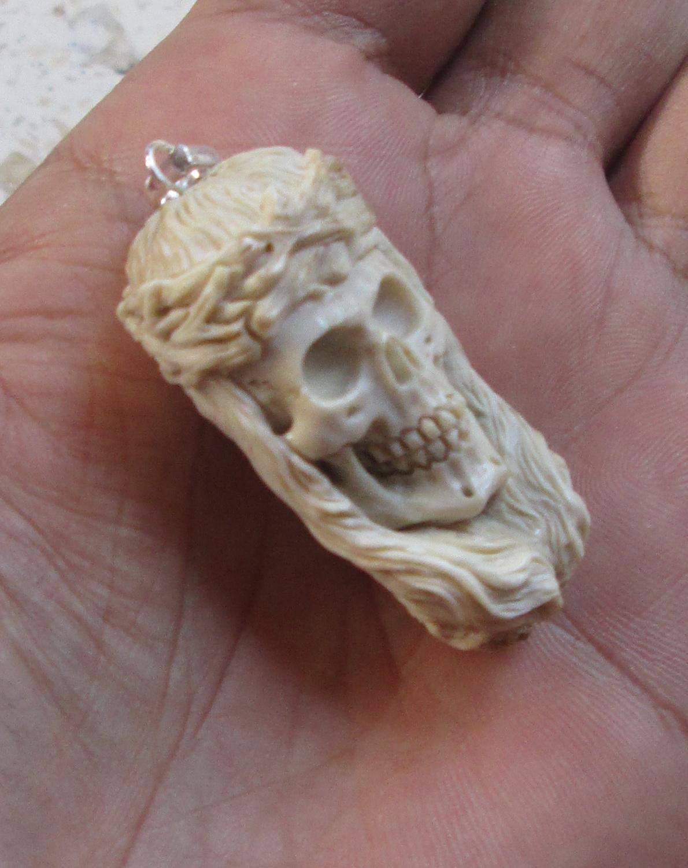 Yesus Skull Carving Pendant in Antler