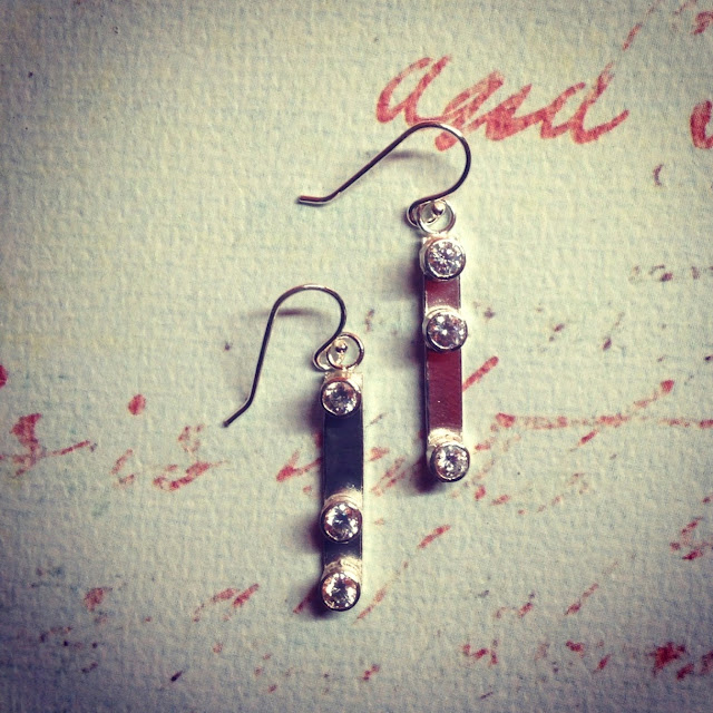 Pretty silver tube set earrings