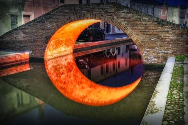 This take on the Moon Bridge features an illumination from underneath, creating a glowing crescent in the reflection.