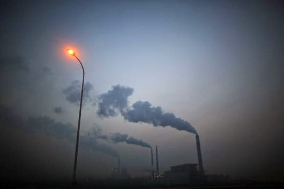 Smoke rises from chimneys of a thermal power plant near Shanghai March 26, 2014.  (Credit: Reuters/Carlos Barria) Click to enlarge.