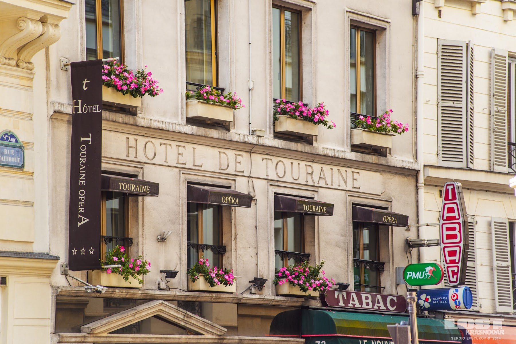Flowers on facades of Paris buildings