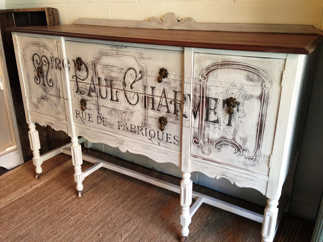 An antique typography vintage french advertisement buffet