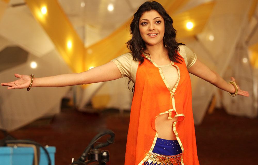 Glorious hot Kajal agarwal in orange dress latest photos from a song