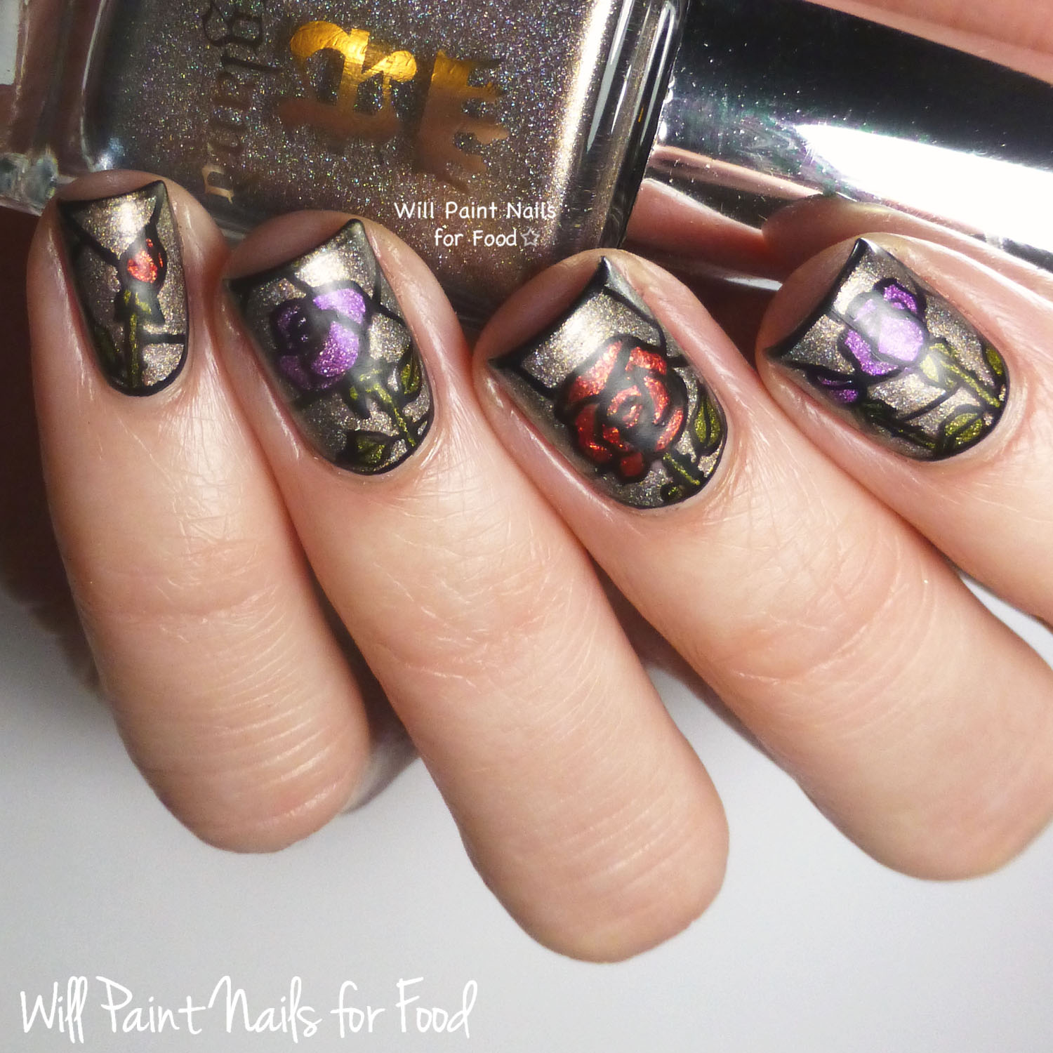 Stained glass roses featuring A England