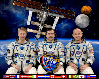 ISS Expedition 13 Crew Photo with mission insignia Reiter Vinogradov Williams.