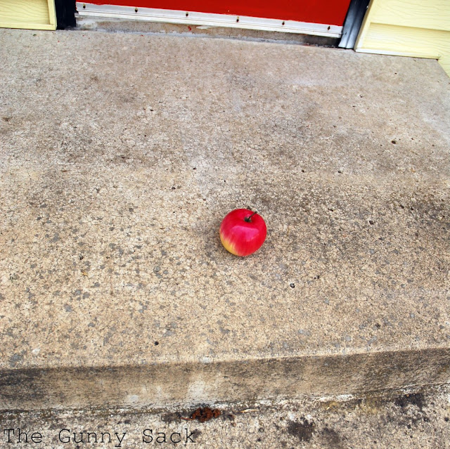 Apple On Cement Stairs