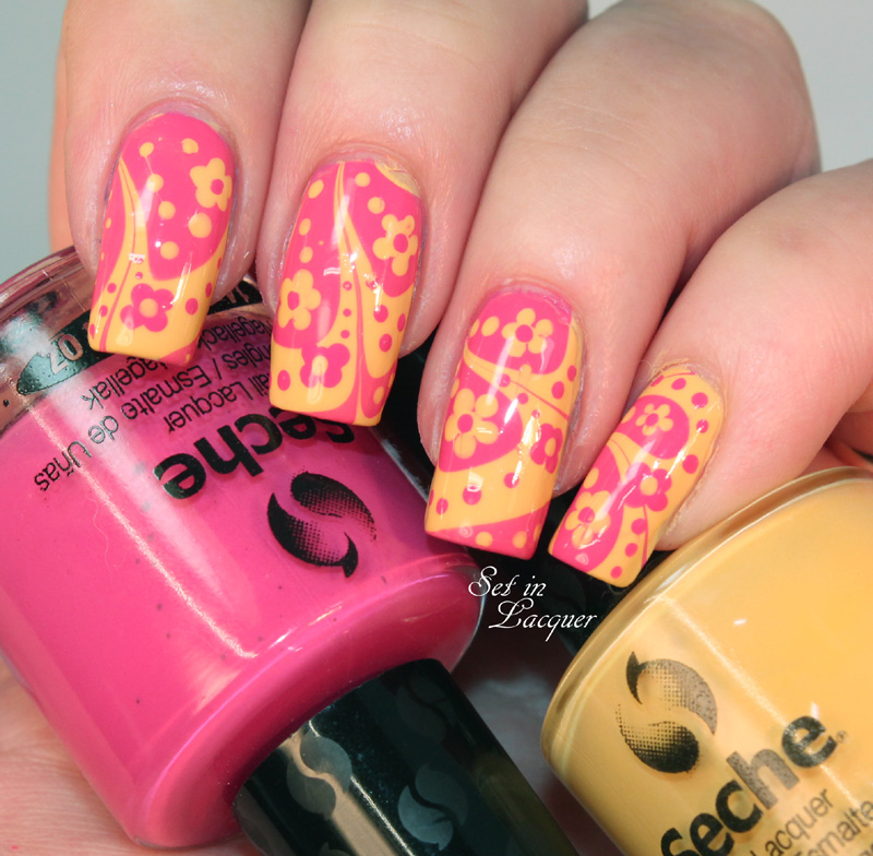 Water marble nail art with floral dotted accents