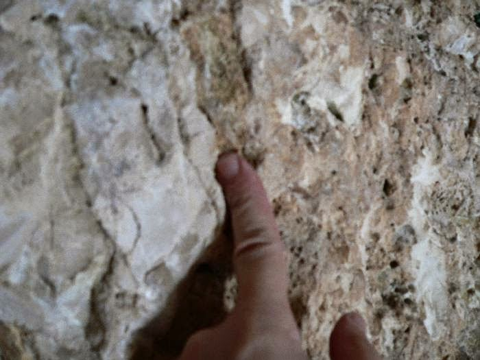 Simon pointing at chisel marks inside the Garden Tomb