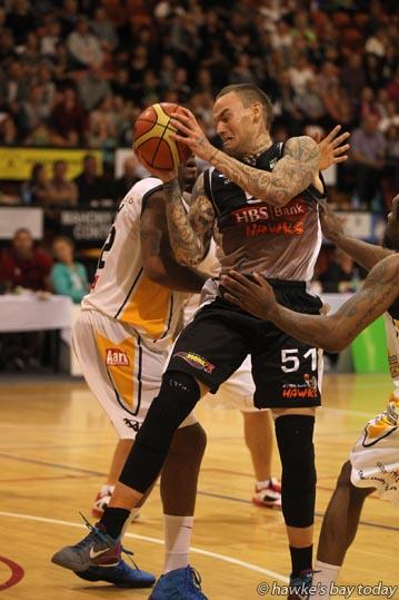 With ball: Sam Walker, Bay Hawks, playing Otago Nuggets - basketball at Pettigrew.Green Arena, Taradale, Napier photograph