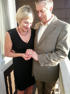 Chip and Jan look at their wedding rings - Ceremony officiated by Patricia Stimac, Seattle Elope