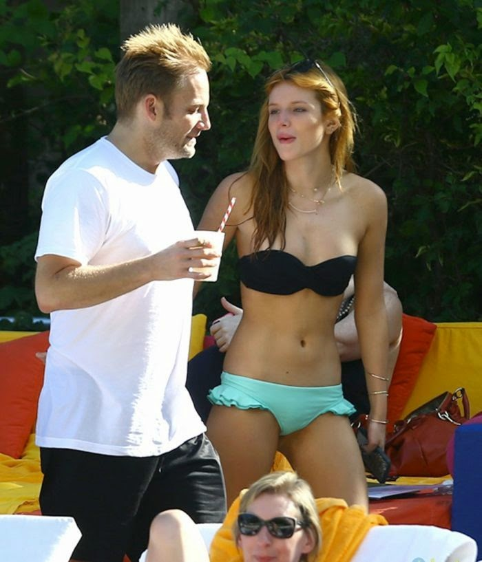 The actress and singer certainly know about how to spending the moment as she landed her amazing physique in a dark top and turquoise two-piece at Miami, FL, USA on Monday, November 17, 2014.