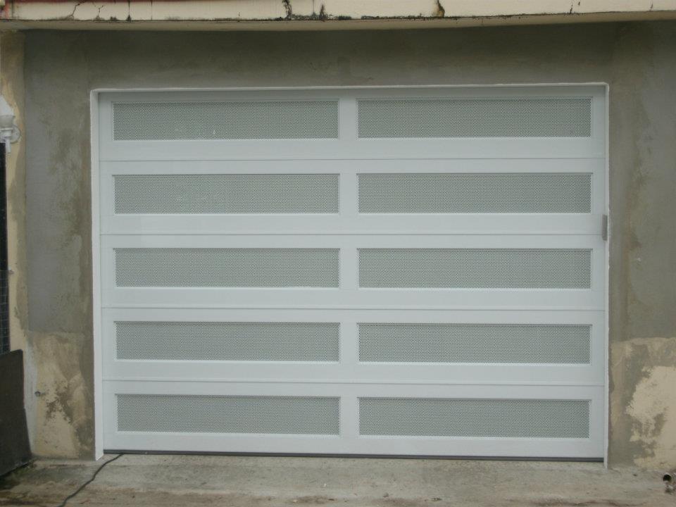 Dise o tropical inc puertas de garage - Puertas para garages ...