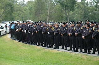 Police officers pay tribute to Zaruba at his funeral