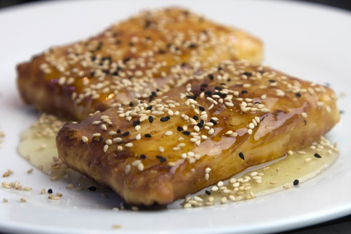 Feta cheese in foil with honey and sesame, Mediterranean Diet, Greek Recipe,