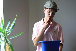 Student, recycling bin, pondering, uOttawa