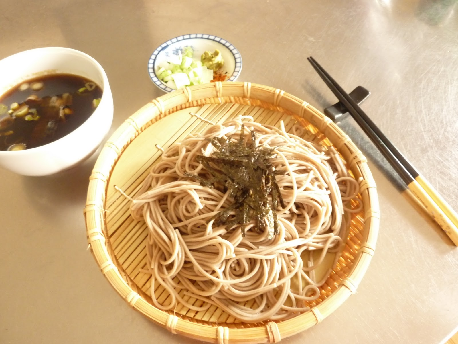 ... soba noodles, and dip them in the sauce, with a bit of wasabi and