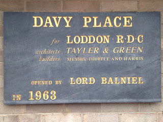 a plaque from one of the buildings, inscribed with 'Davy Place, for Loddon R.D.C.  Architects Tayler and Green...'