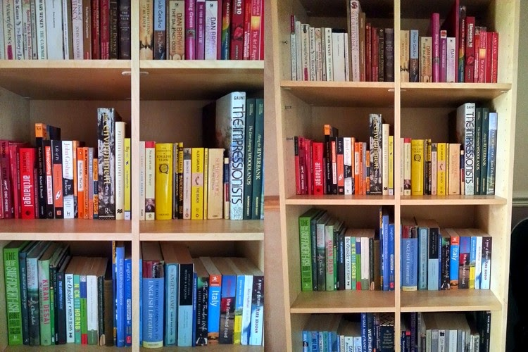 Arrange books bookcase by colour color rainbow