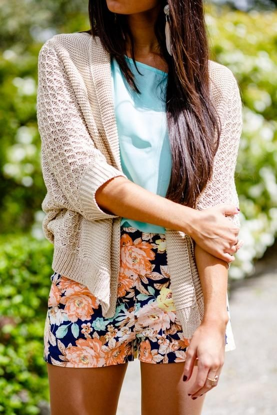 Loose sweater, blue shirt and colorful skirt for ladies street style