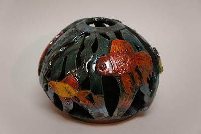 Unique and beautiful raku fired pottery vessel with fish bowl design.