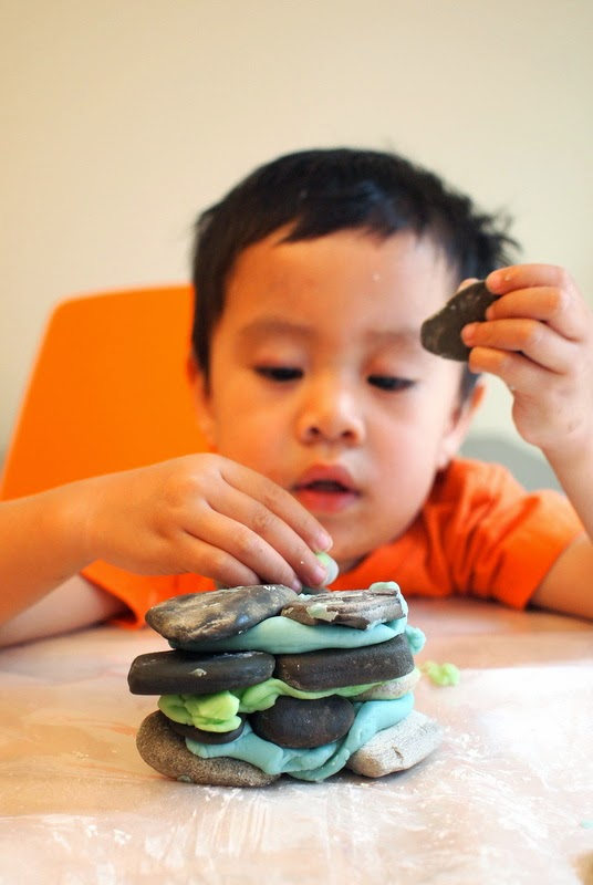 building a play dough and rock house