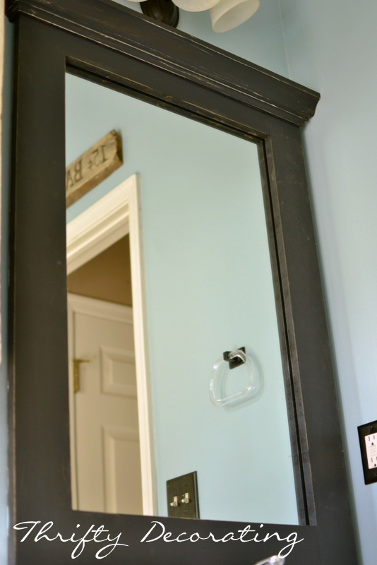Thrifty Decorating: Frame Your Bathroom Mirror.