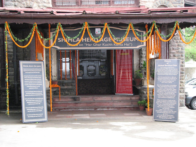 """Shimla Heritage Museum: An eye opener for touristsVandana Bhagra, ShimlaPhotos: By me History can be interesting as well as inspiring and when coupled with life-size images it adds colour to ones imagination. And rather than leaving things to imagination the state tourism department has given shape to it in form of the recently inaugurated 'Shimla Heritage Museum' based on the concept of 'har ghar kuch kehta hai'. Taking a step further this museum is housed in the 120 year old building which is prevalently known as the US Club dating back to almost 1860s, which has been renovated on similar line to the original structure to preserve its wholesomeness. As you enter the building you are reminded of Shimla down the years and a brief write up on the history of the United Service Club is good for enlightenment. The not so huge room inside, though just an attempt to capture the history of Shimla, holds nearly 50 huge portraits and sketches of Shimla dating to the Colonial period. Old timers can definitely associate with all the old building but the young and those visiting for the first time will be left mesmerizing with the beauty and legacy of Shimla. Some of the rare photographs adorning the walls include pictures of magnificent buildings such as the Viceregal Lodge, Rippon Hospital, Post Office, Town Hall, Gaiety Theatre, Combermere Bridge, Vidhan Sabha, Gorton Castle, Railway Board, Central Telegraph Office, the ARTRAC Complex and Barnes Court to name a few. Below the black and white sketches you can see the originals in coloured to give you a feel of the present day.  Dr Arun Sharma, Director Tourism and Civil Aviation says """"Though at present we have very limited space, expansion plans are on anvil as and when we are provided with more space. An attempt has been made to re-discover Shimla's soul and through this museum we wish to fulfill the curiosity of the visitors. Heritage walks, timely tours, a training centre for tourists guides as well as related tourist acti"""