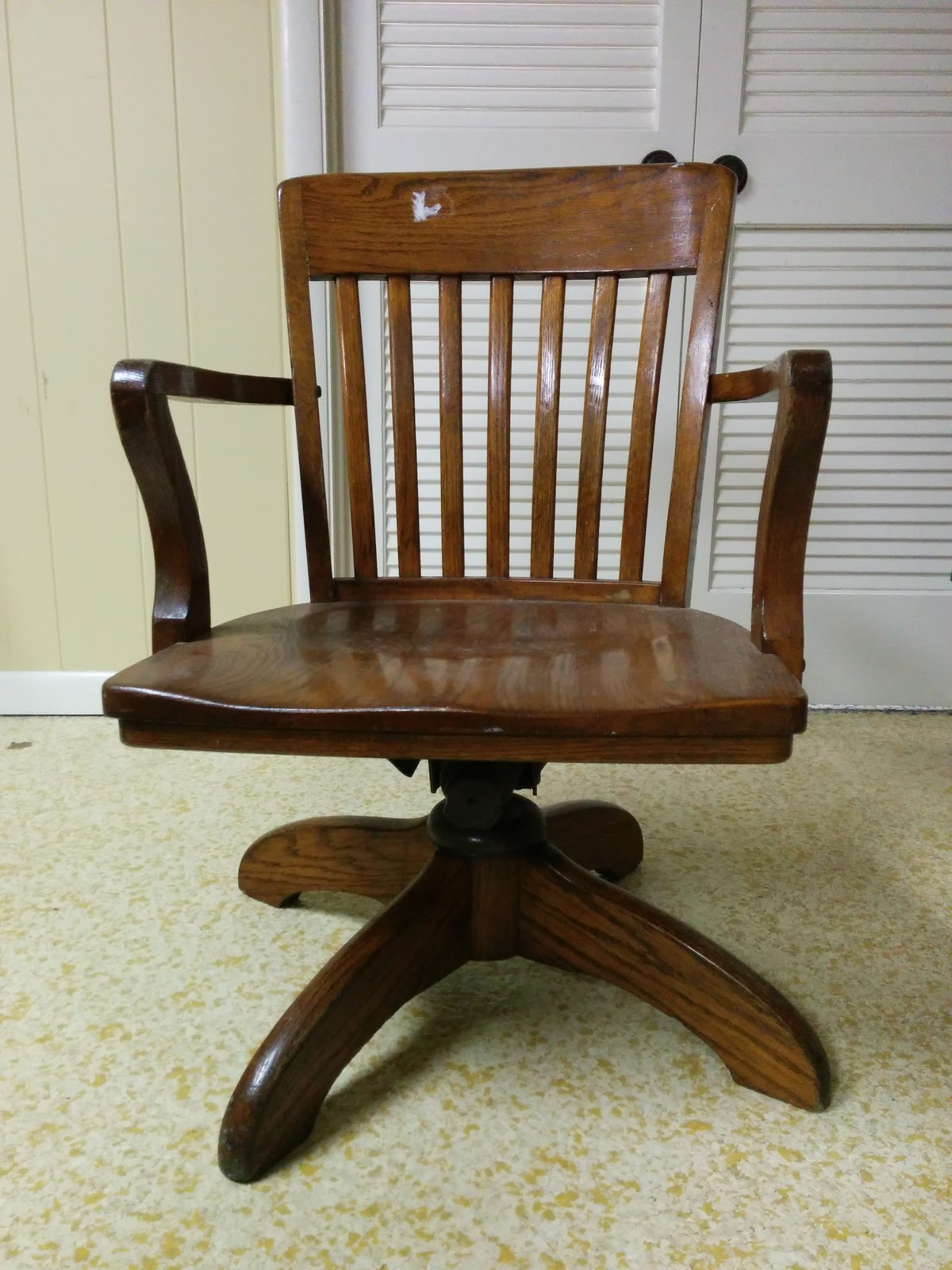 Vintage wooden office chair before repairs, new wheels, and fresh paint