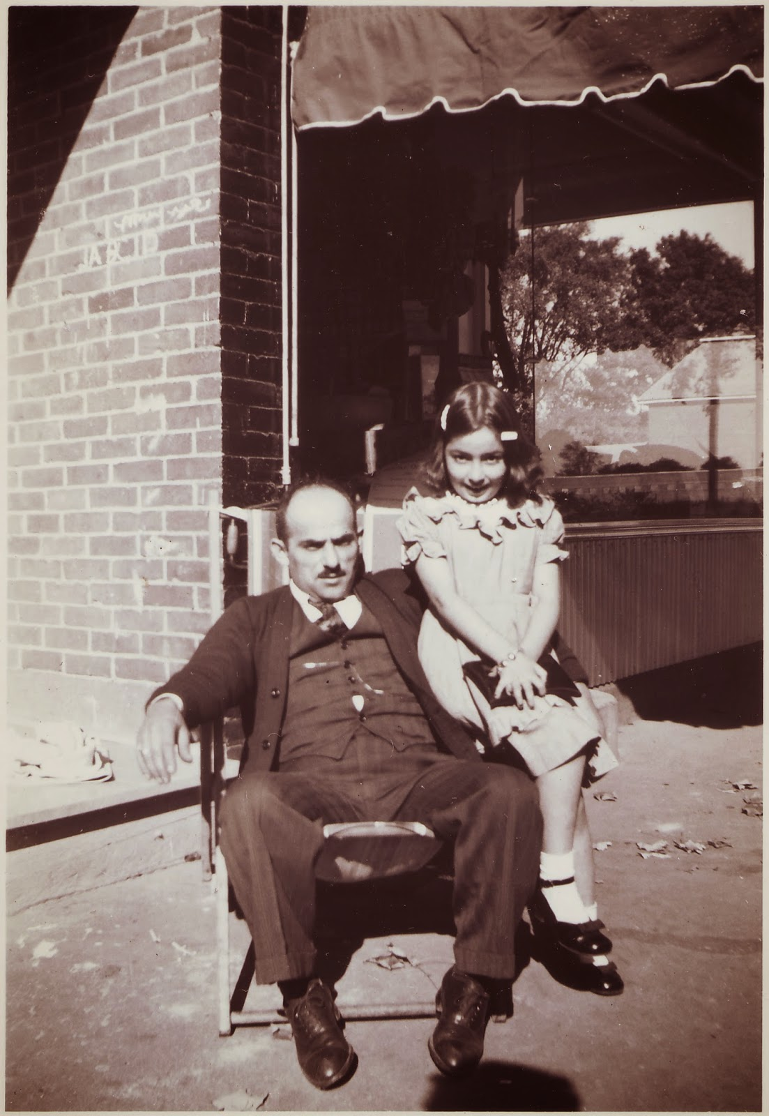 George Monsour and daughter Carolyn outside their store, mid-late 1940s.