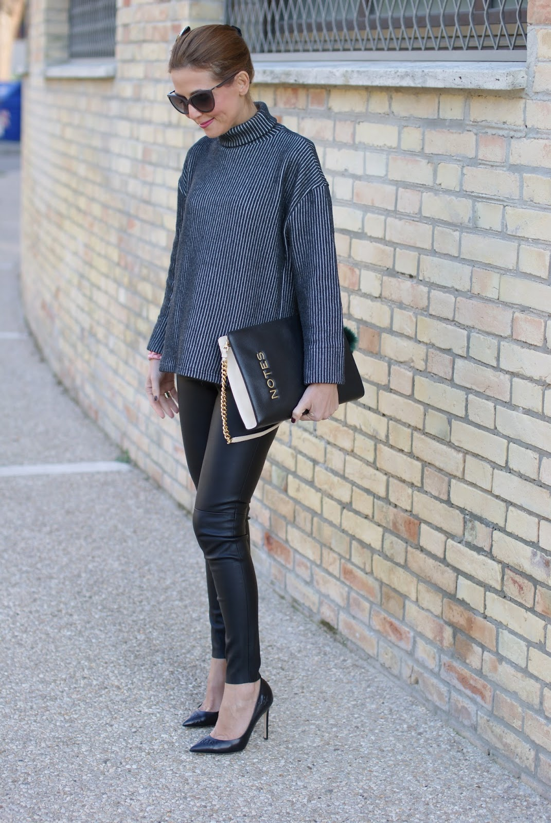 Chic and sophisticated look with a Vogos sweater, faux leather pants and black pumps on Fashion and Cookies fashion blog, fashion blogger style