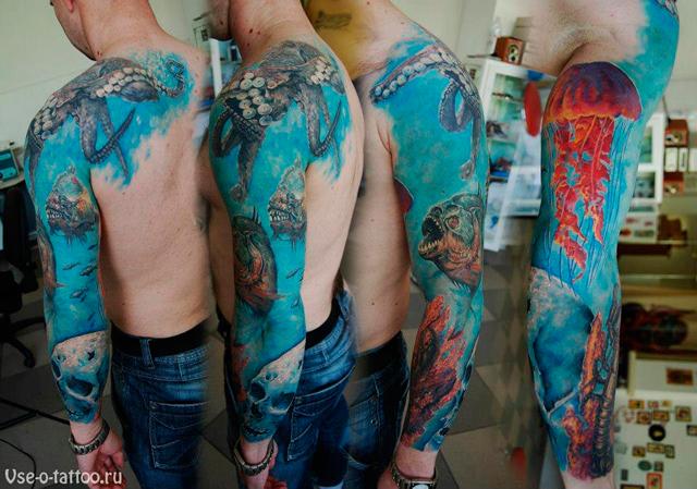 Tatuagem no braço tema oceano