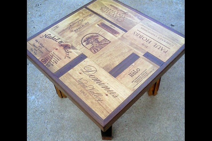 this is a wine crate coffee table meets wine bar it has roomy shelves underneath as well the tabletop is a variety of wine crate panel ends alpine wine design outdoor