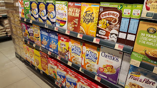 the cereal aisle in the food store at the nearby mall
