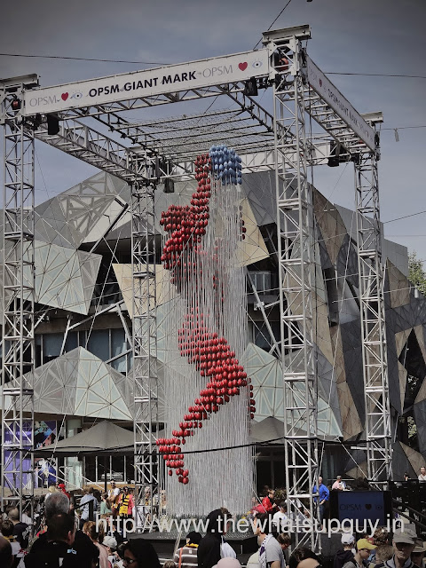 Football in Federation Square for AFL Parade