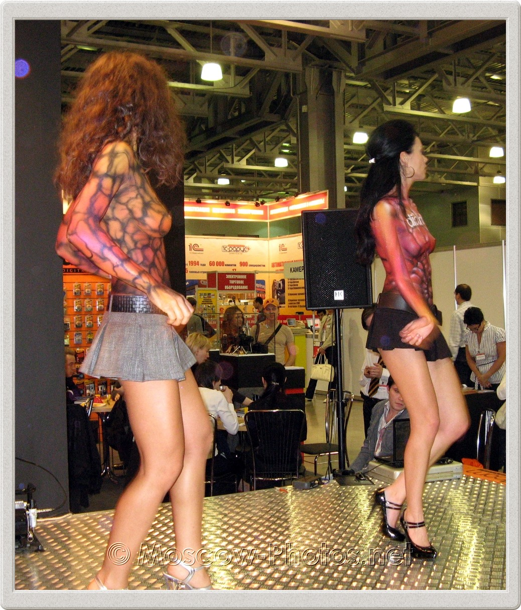 Body painted dancing girls in mini skirts.