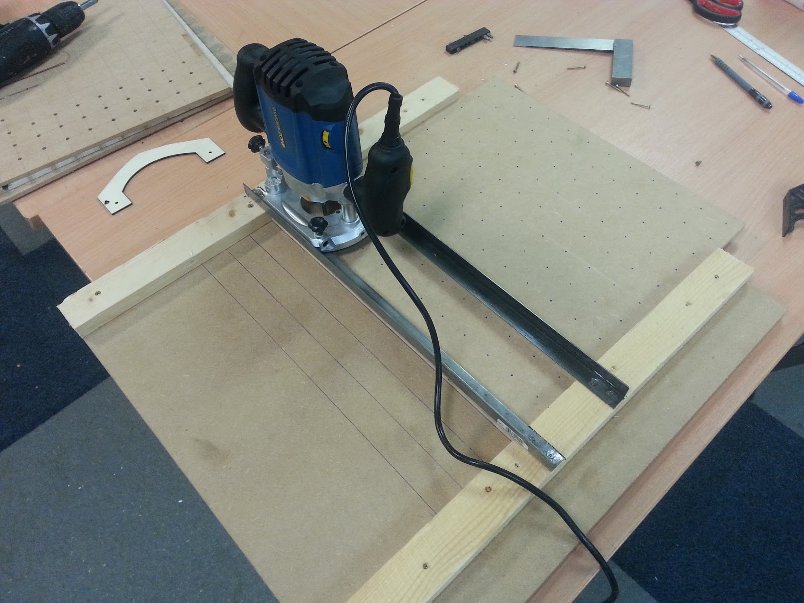... PDBs will fit perfectly into the grooves, was a real pain, so we've  come up with a simple router jig, out of offcuts of wood and scrap metal  runners.