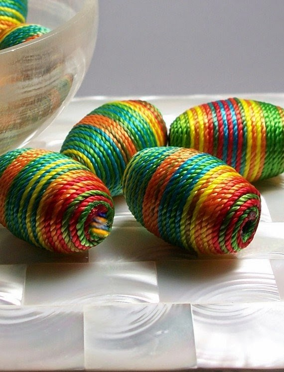 https://www.etsy.com/listing/71085573/bead-multi-color-cord-wrapped-oval-shape?ref=favs_view_6