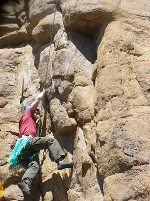 Benjamin Rubenstein rock-climbing in hula skirt in Estes Park