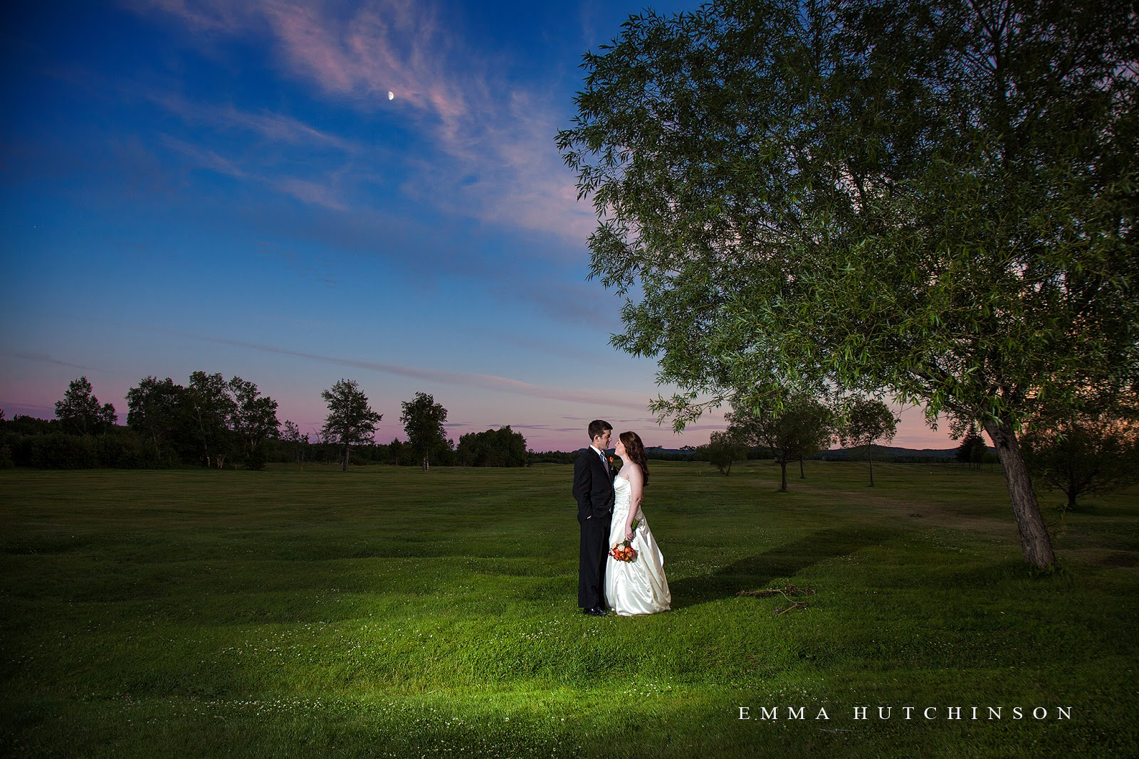 Bride and Groom enjoying the sunset at Grand Falls Golf Club