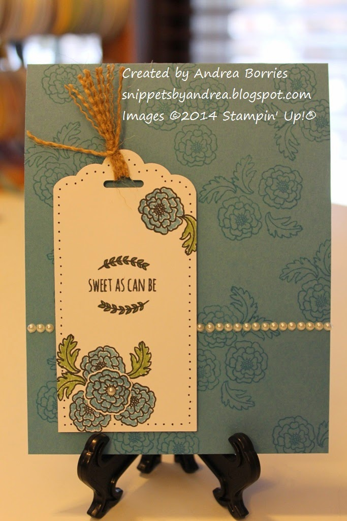 "Blue card with floral background. The focal point is a white tag stamped with flowers and the sentiment ""Sweet as can be."""