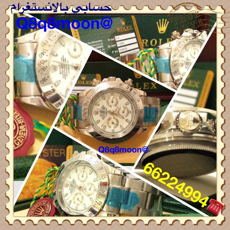 ساعة رجالي تقليد رولكس دايتونا (لون فضي  مينا أبيض ) بالعلبه و الكرت و الاوراق