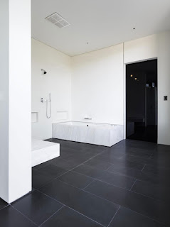 back and white spacious bath room